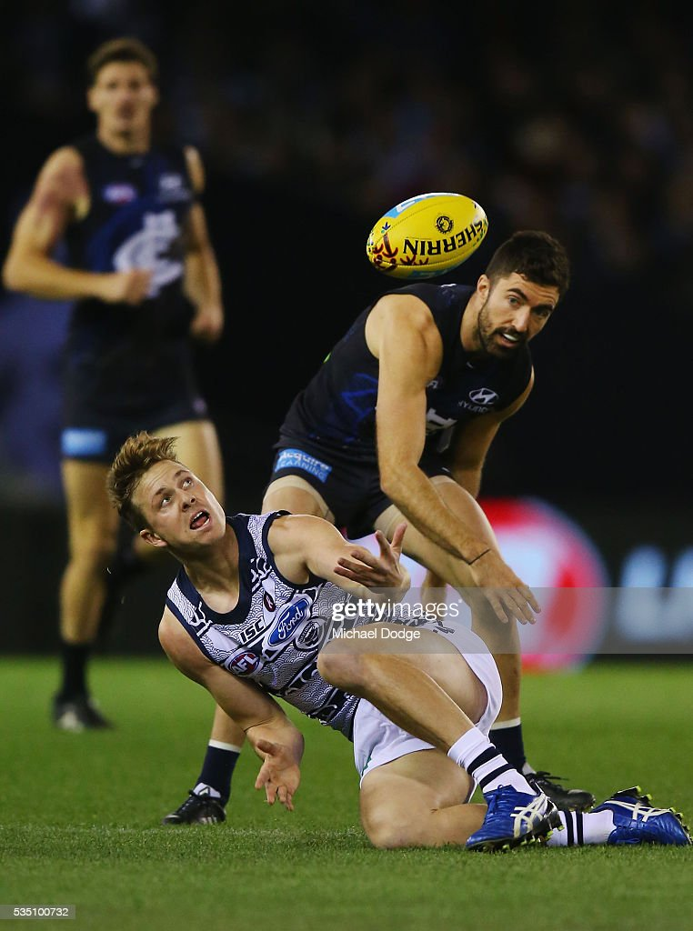 Mitch Duncan of the Cats (L) and Kade Simpson of the Blues compete for the ball during the round 10 AFL match between the Carlton Blues and the Geelong Cats at Etihad Stadium on May 29, 2016 in Melbourne, Australia.