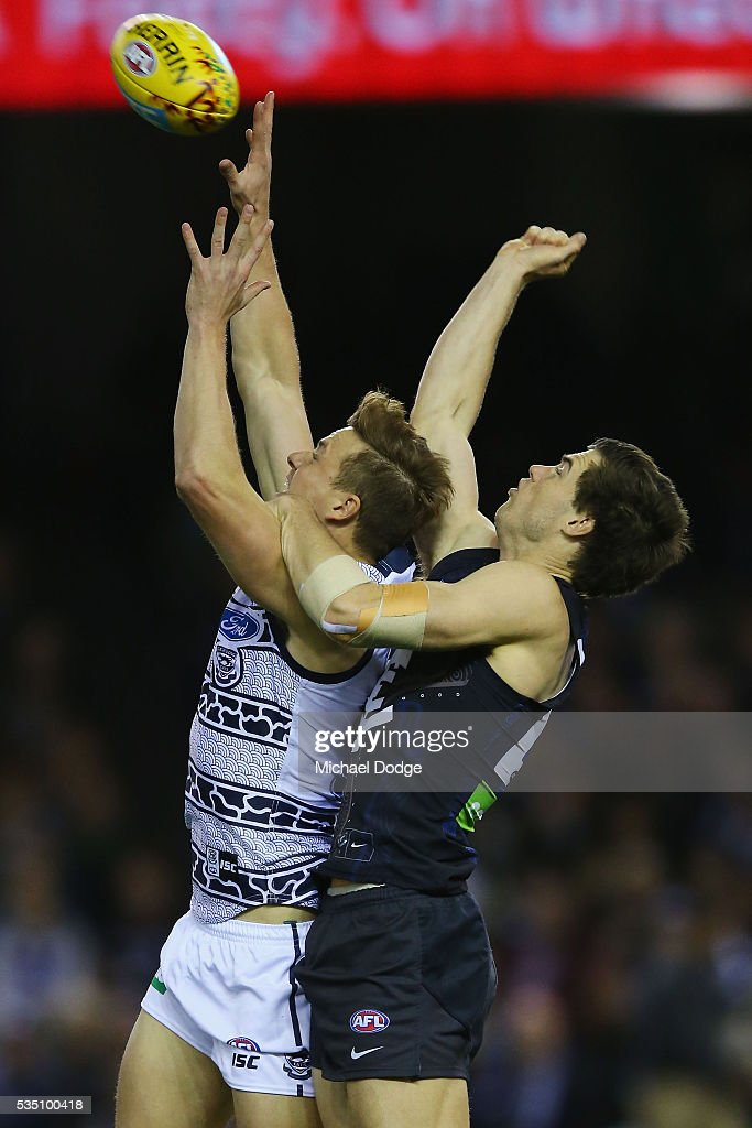 Mitch Duncan of the Cats (L) and Lachie Plowman of the Blues compete for the ball during the round 10 AFL match between the Carlton Blues and the Geelong Cats at Etihad Stadium on May 29, 2016 in Melbourne, Australia.