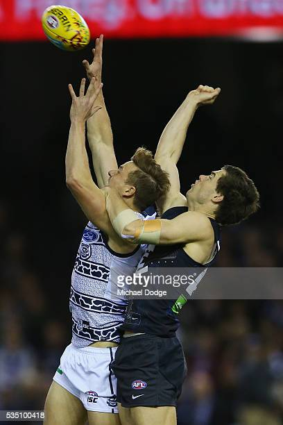 Mitch Duncan of the Cats and Lachie Plowman of the Blues compete for the ball during the round 10 AFL match between the Carlton Blues and the Geelong...