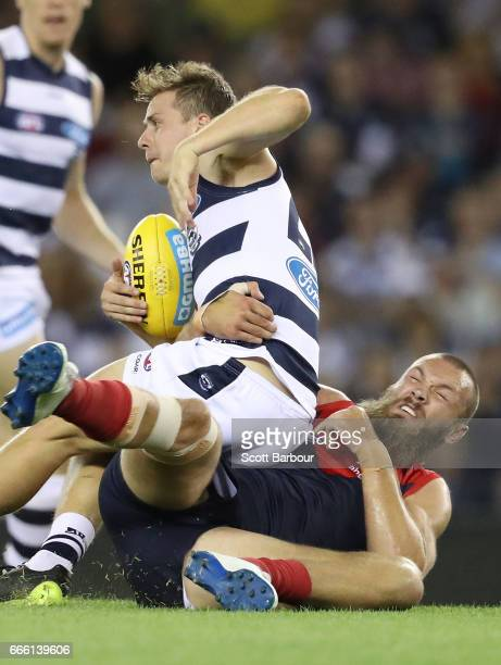 Mitch Duncan of the Cats is tackled by Max Gawn of the Demons during the round three AFL match between the Geelong Cats and the Melbourne Demons at...
