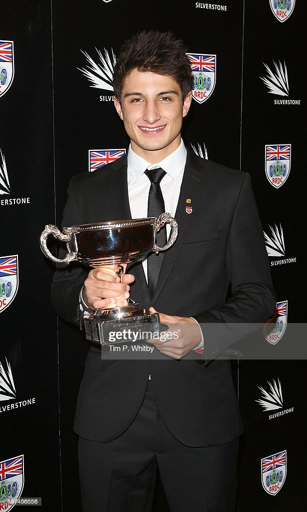 <a gi-track='captionPersonalityLinkClicked' href=/galleries/search?phrase=Mitch+Evans&family=editorial&specificpeople=8042623 ng-click='$event.stopPropagation()'>Mitch Evans</a> with the Bruce McLaren Trophy awarded to the commonwealth driver who has established the most meritorious performance in international motor racing at the British Racing Drivers Club awards at Grand Connaught Rooms on December 3, 2012 in London, England.