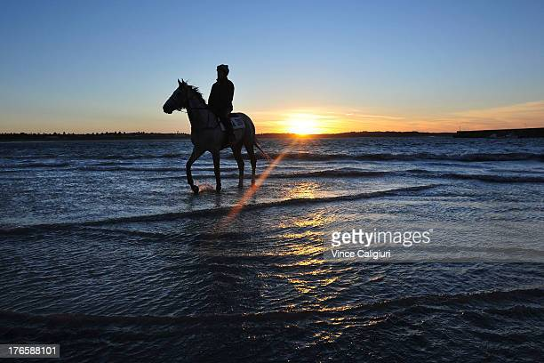 Mitch Freedman riding Melbourne Cup favourite Puissance de Lune during trackwork session at Lady Bay beach on August 16 2013 in Warrnambool Australia