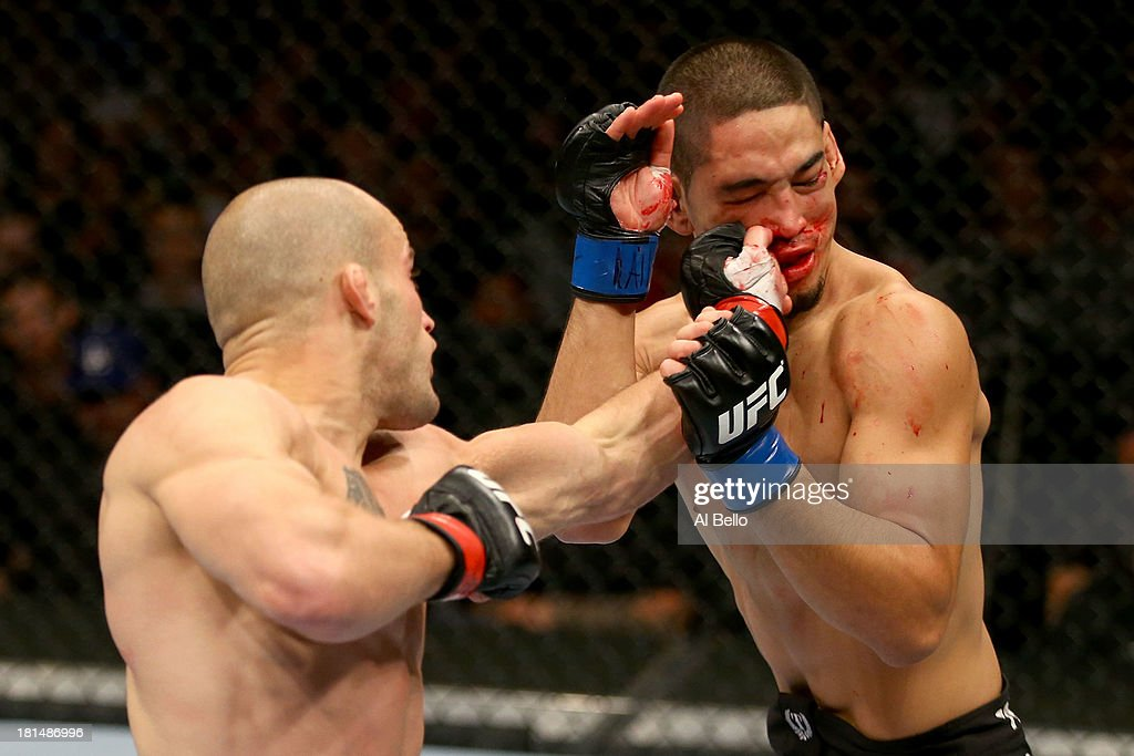 Mitch Gagnon punches Dustin Kimura in their UFC bantamweight bout at the Air Canada Center on September 21, 2013 in Toronto, Ontario, Canada.