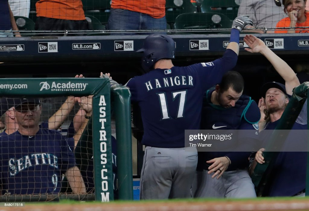 Mitch Haniger #17 of the Seattle Mariners celebrates with teammates in the dugout after hitting a home run in the ninth inning against the Houston Astros at Minute Maid Park on September 16, 2017 in Houston, Texas.