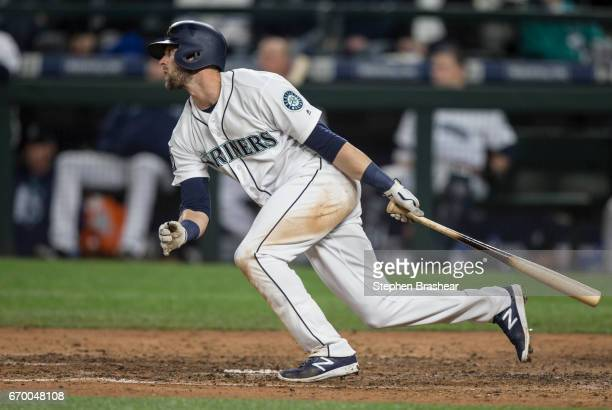 Mitch Haniger of the Seattle Mariners hits a double off of relief pitcher Kyle Barraclough of the Miami Marlins to break up a nohitter during the...