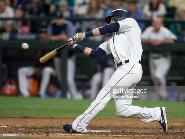 Mitch Haniger of the Seattle Mariners hits a double off of relief pitcher Santiago Casilla of the Oakland Athletics during the ninth inning of a game...