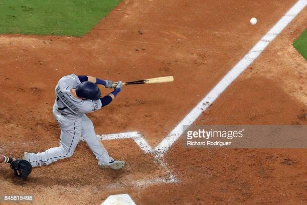 Mitch Haniger of the Seattle Mariners hits a home run in the third inning against the Texas Rangers at Globe Life Park in Arlington on September 11...