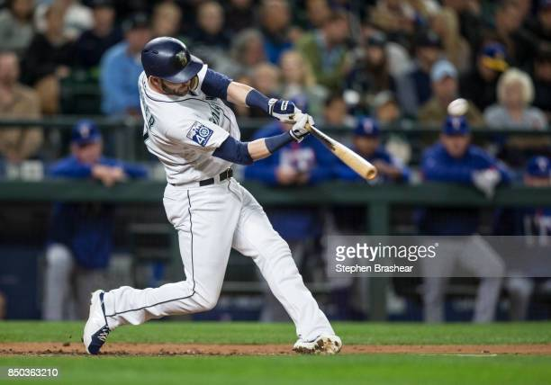 Mitch Haniger of the Seattle Mariners hits a solo home run off of starting pitcher Andrew Cashner of the Texas Rangers during the third inning of a...