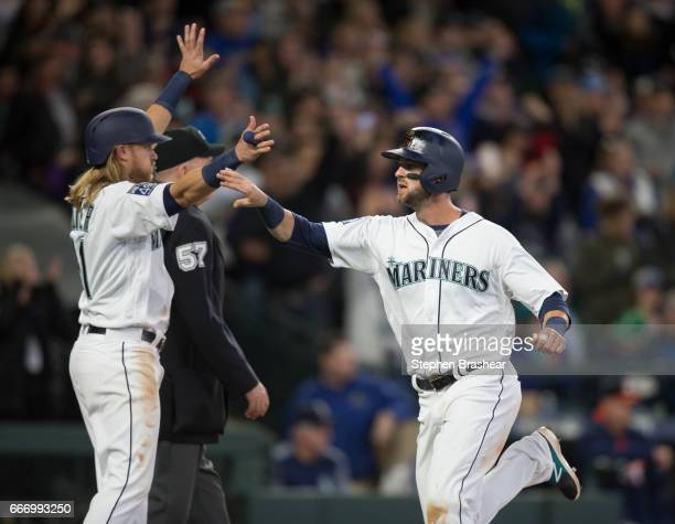 Mitch Haniger of the Seattle Mariners is congratulated by Taylor Motter after Motter snd Haniger scored on a tworun single off the bat of Nelson Cruz...