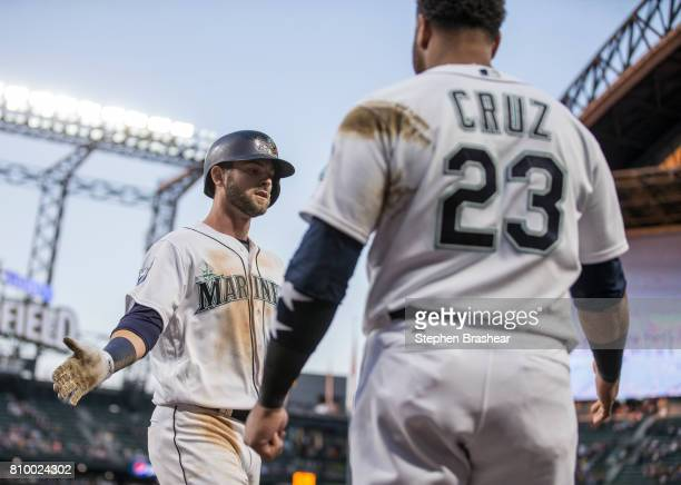 Mitch Haniger of the Seattle Mariners is greeted by Nelson Cruz of the Seattle Mariners after hitting a solo home run off of starting pitcher Paul...