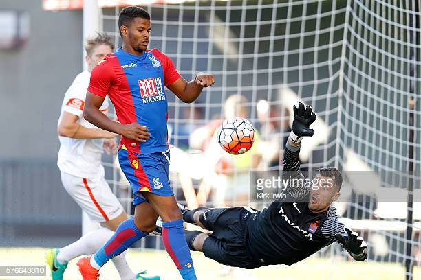 Mitch Hildebrandt of FC Cincinnati stops a shot from Fraizer Campbell of Crystal Palace FC during the first half at Nippert Stadium on July 16 2016...