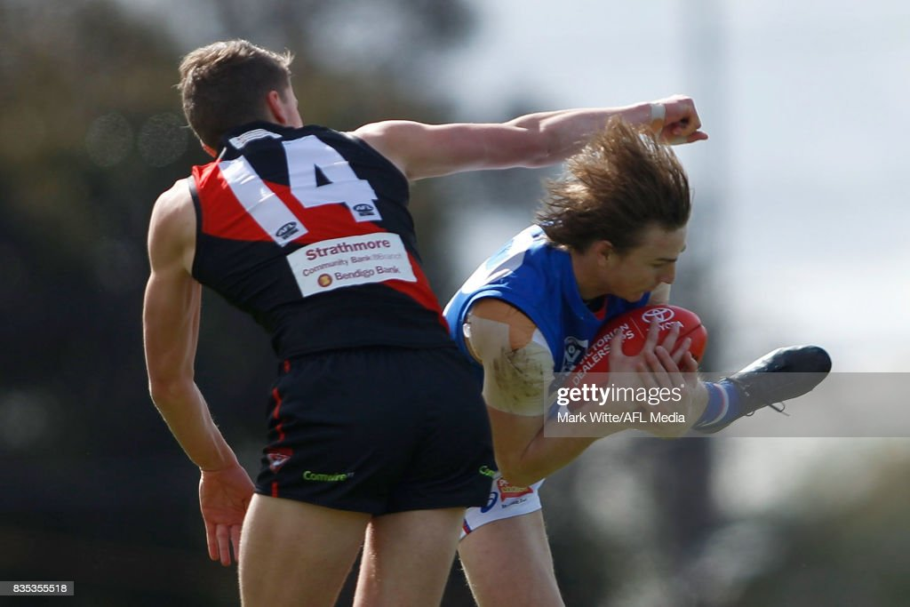 Mitch Honeychurch of Footscray Bulldogs marks the ball infront of Jordan Ridley of Essendon Bombers during the round 18 VFL match between the Essendon Bombers and Footscray Bulldogs at Windy Hill on August 19, 2017 in Melbourne, Australia.