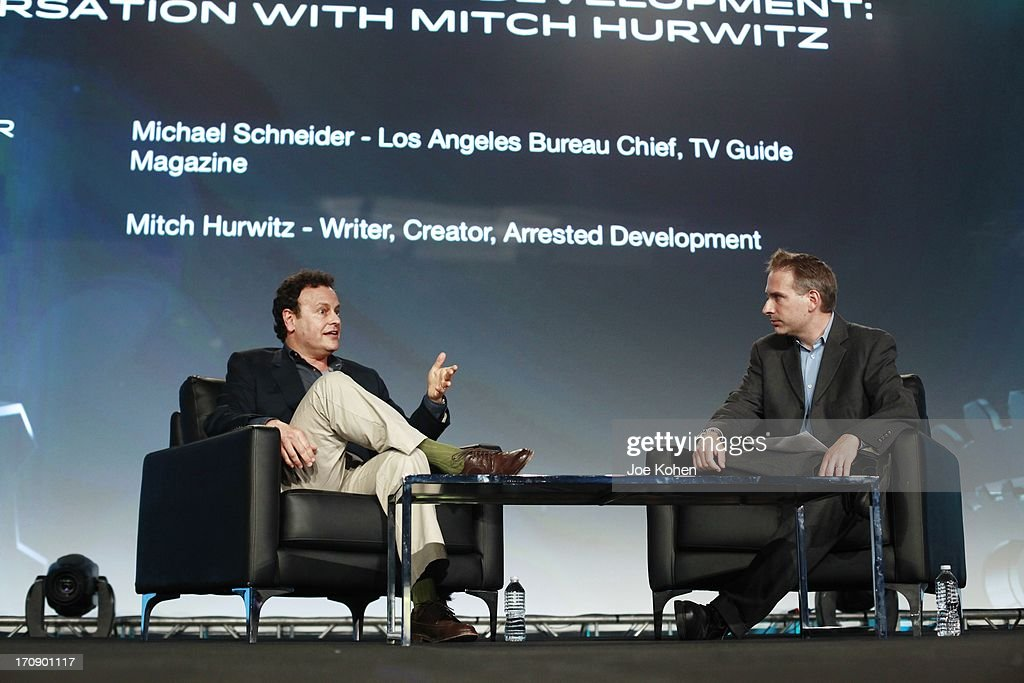 Mitch Hurwitz (L) writer/creator of 'Arrested Development' speaks with interviewer Michael Schneider, Los Angeles Bureau Chief of TV Guide Magazine during PROMAXBDA 2013 at JW Marriott Los Angeles at L.A. LIVE on June 19, 2013 in Los Angeles, California.