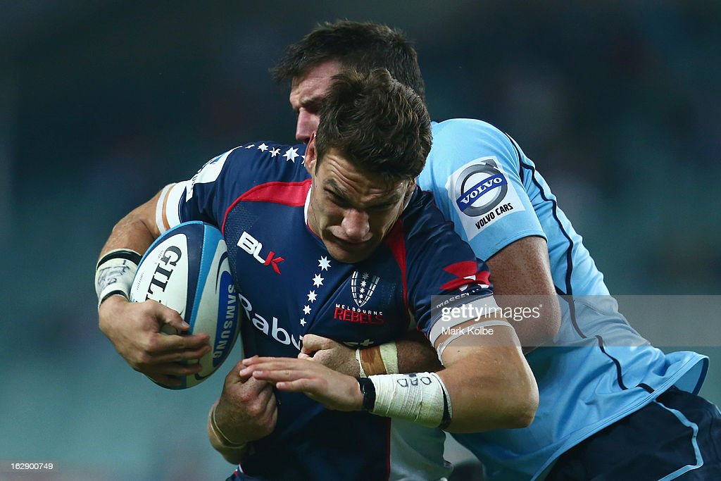 Mitch Inman of the Rebels is tackled during the round three Super Rugby match between the Waratahs and the Rebels at Allianz Stadium on March 1, 2013 in Sydney, Australia.