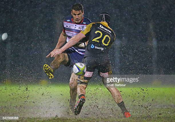 Mitch Inman of the Rebels kicks the ball during the Super Rugby Exhibition match between the Rebels and the Hurricanes at Harlequins Rugby Club on...