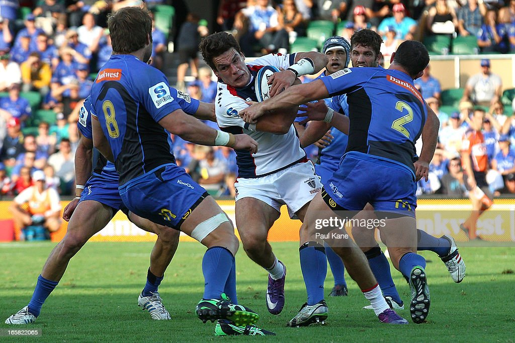 Mitch Inman of the Rebels looks to break thru Forces defence the during the round eight Super Rugby match between the Western Force and the Melbourne Rebels at nib Stadium on April 6, 2013 in Perth, Australia.