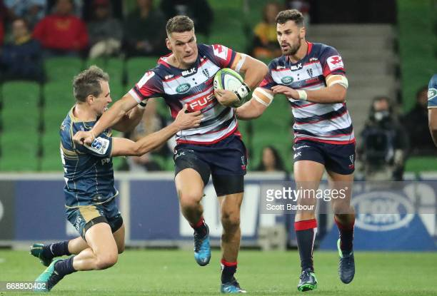 Mitch Inman of the Rebels runs with the ball during the round eight Super Rugby match between the Rebels and the Brumbies at AAMI Park on April 15...