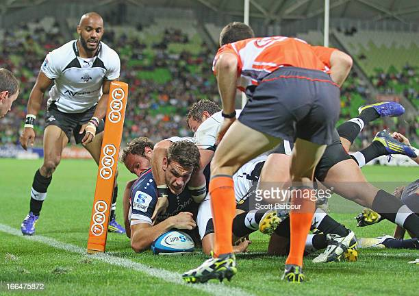 Mitch Inman of the Rebels scores a try during the round nine Super Rugby match between the Rebels and the Kings at AAMI Park on April 13 2013 in...