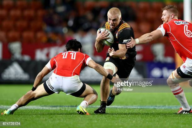 Mitch Karpik of the Chiefs is tackled during the round 10 Super Rugby match between the Chiefs and the Sunwolves at FMG Stadium on April 29 2017 in...