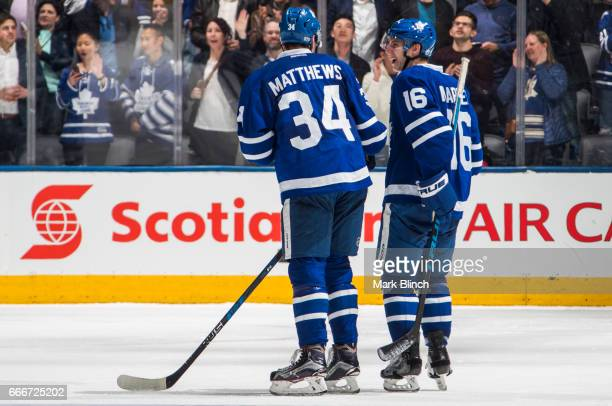 Mitch Marner and Auston Matthews of the Toronto Maple Leafs celebrate after their team clinched a playoff spot against the Pittsburgh Penguins at the...