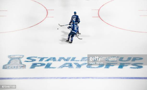 Mitch Marner and Auston Matthews of the Toronto Maple Leafs skate prior to the game against the Washington Capitals in Game Three of the Eastern...