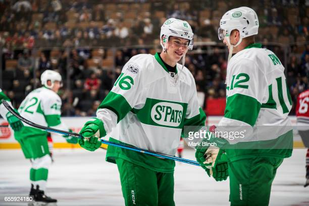 Mitch Marner and Connor Brown of the Toronto Maple Leafs smile during warm up prior to the game against the Chicago Blackhawks Air Canada Centre on...