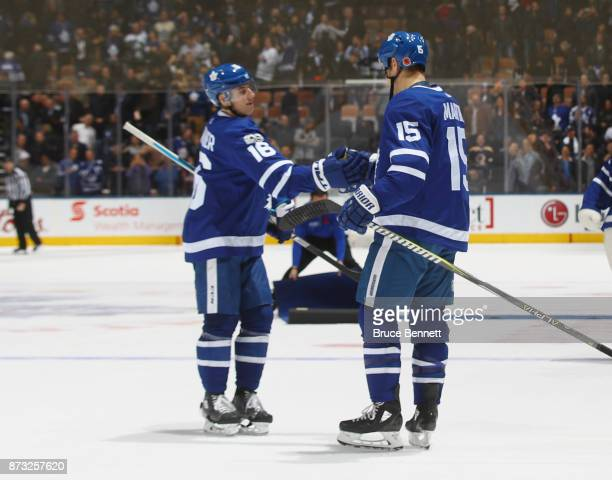 Mitch Marner and Matt Martin of the Toronto Maple Leafs celebrate a win against the Boston Bruins at the Air Canada Centre on November 10 2017 in...