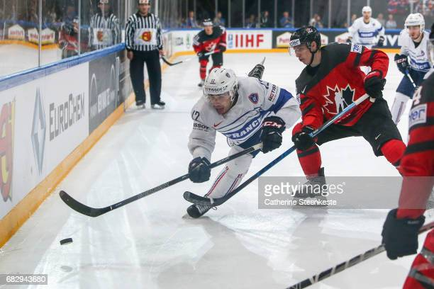 Mitch Marner of Canada challenges Valentin Claireaux of France during the 2017 IIHF Ice Hockey World Championship game between Canada and France at...