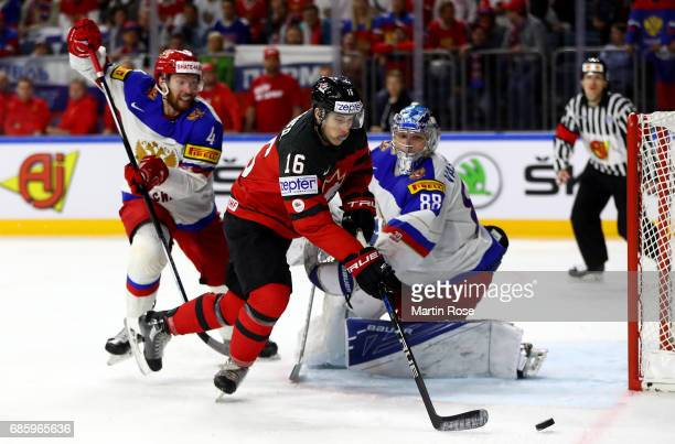 Mitch Marner of Canada challenges Vladislav Gavrikov of Russia for the puck during the 2017 IIHF Ice Hockey World Championship semi final game...