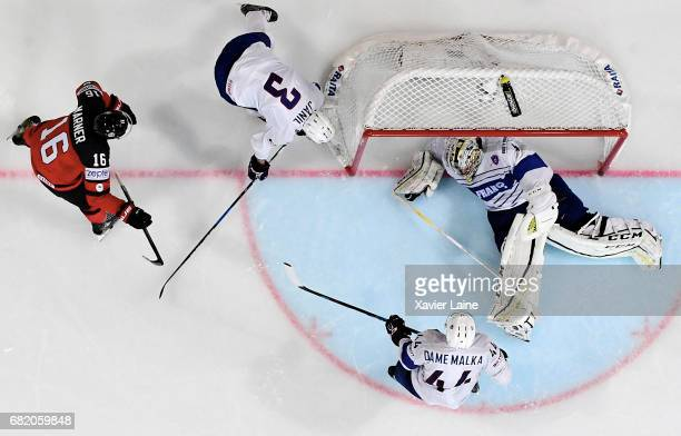 Mitch Marner of Canada scores a goal over Florian Hardy of France during the 2017 IIHF Ice Hockey World Championship game between Canada and France...