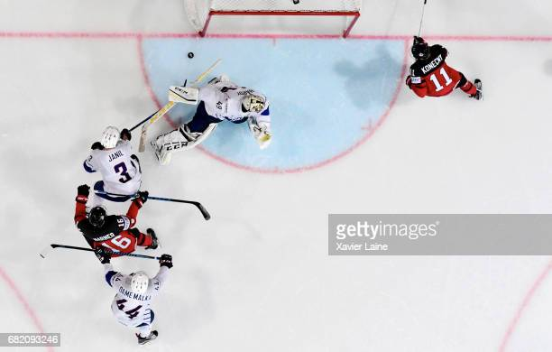Mitch Marner of Canada scores a goal with Travis Konecny over Florian Hardy Jonathan Janil and Olivier DameMalka of France during the 2017 IIHF Ice...