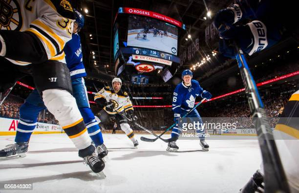 Mitch Marner of the Toronto Maple Leafs and Dominic Moore of the Boston Bruins skate during the first period at the Air Canada Centre on March 20...