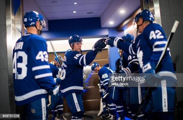 Mitch Marner of the Toronto Maple Leafs and teammate Tyler Bozak prepare to take the ice for warm up before facing the Ottawa Senators at the Air...