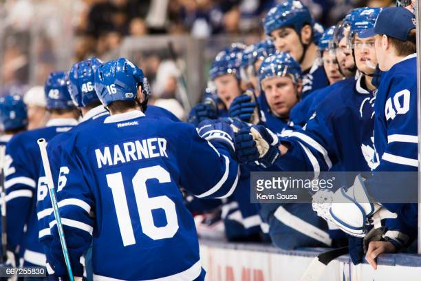 Mitch Marner of the Toronto Maple Leafs celebrates a Maple Leafs goal against the Columbus Blue Jackets with teammates during the second period at...
