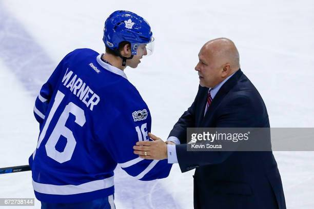 Mitch Marner of the Toronto Maple Leafs congratulates head coach Barry Trotz of the Washington Capitals after the Capitals defeated the Leafs during...