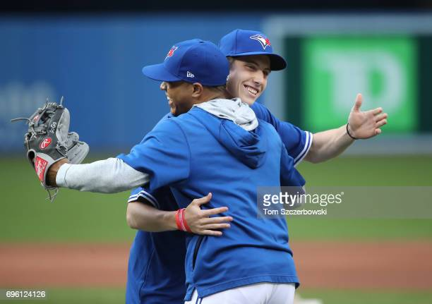 Mitch Marner of the Toronto Maple Leafs embraces Marcus Stroman of the Toronto Blue Jays after throwing out the first pitch before the start of the...
