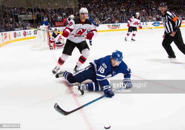 Mitch Marner of the Toronto Maple Leafs falls as he works against Steven Santini of the New Jersey Devils during the second period at the Air Canada...