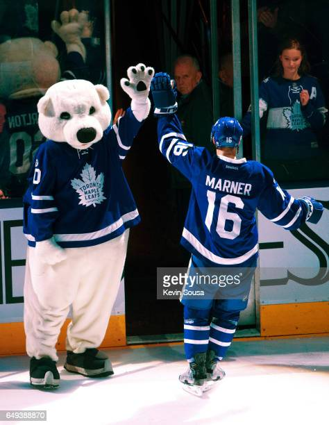 Mitch Marner of the Toronto Maple Leafs high fives the Leafs mascot Carlton the Bear after the Leafs defeated the Detroit Red Wings at the Air Canada...