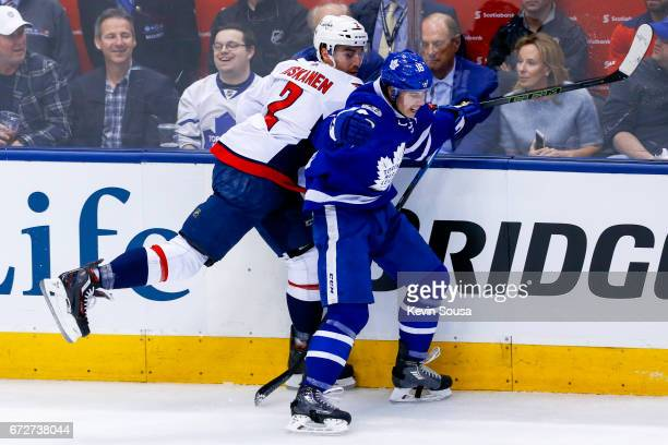Mitch Marner of the Toronto Maple Leafs hits Matt Niskanen of the Washington Capitals during the first period in Game Six of the Eastern Conference...