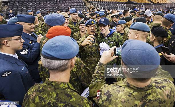 Mitch Marner of the Toronto Maple Leafs mingles with members of the Canadian Armed Forces at the Air Canada Centre on January 21 2017 in Toronto...