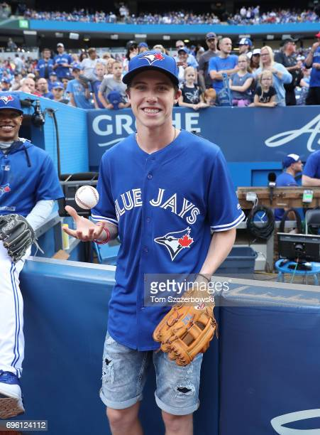 Mitch Marner of the Toronto Maple Leafs poses for a photo before throwing out the first pitch before the start of the Toronto Blue Jays MLB game...