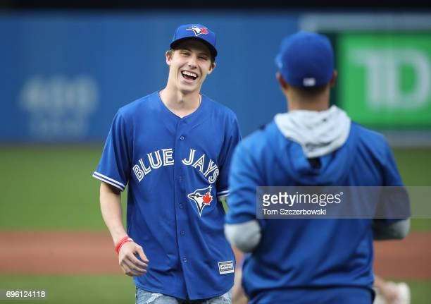 Mitch Marner of the Toronto Maple Leafs shares a smile with Marcus Stroman of the Toronto Blue Jays after throwing out the first pitch before the...