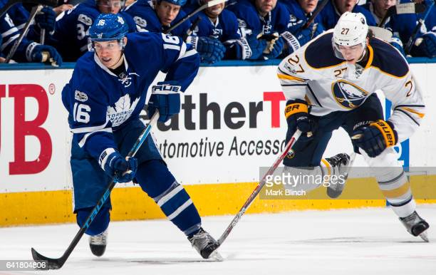 Mitch Marner of the Toronto Maple Leafs skates against Derek Grant of the Buffalo Sabres during the first period at the Air Canada Centre on February...