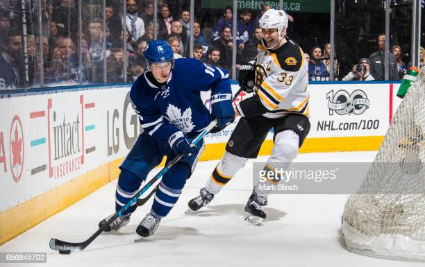 Mitch Marner of the Toronto Maple Leafs skates against Zdeno Chara of the Boston Bruins during the third period at the Air Canada Centre on March 20...