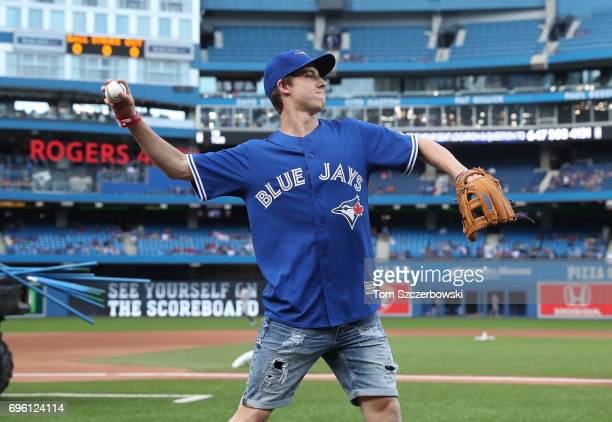 Mitch Marner of the Toronto Maple Leafs warms up before throwing out the first pitch before the start of the Toronto Blue Jays MLB game against the...