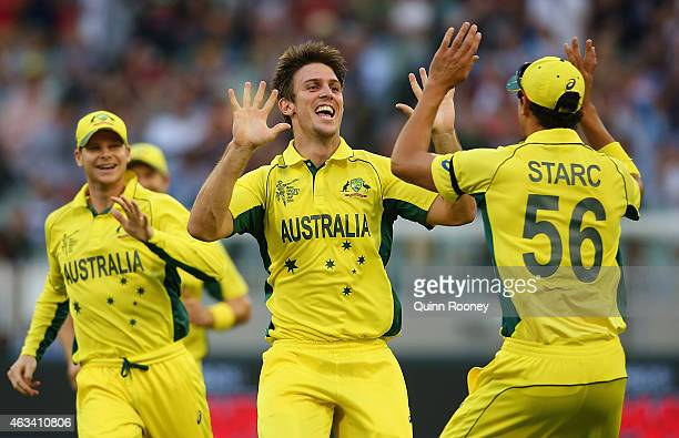 Mitch Marsh and Mitchell Starc of Australia celebrate taking the wicket of Ian Bell of England during the 2015 ICC Cricket World Cup match between...