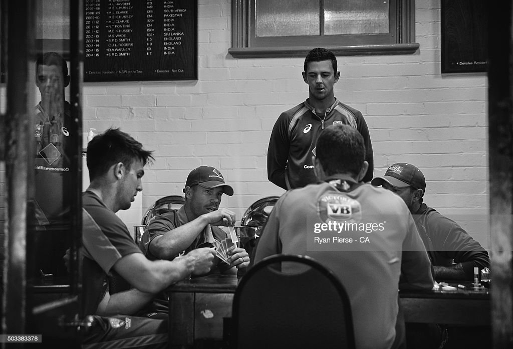 Mitch Marsh David Warner and Josh Hazlewood of Australia play cards in the change rooms after rain delayed the start of play during day three of the...