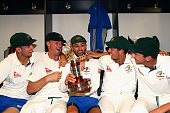 Mitch Marsh Jackson Bird Nathan Lyon James Pattinson and Josh Hazlewood of Australia celebrate with the TransTasman Trophy in the change rooms after...
