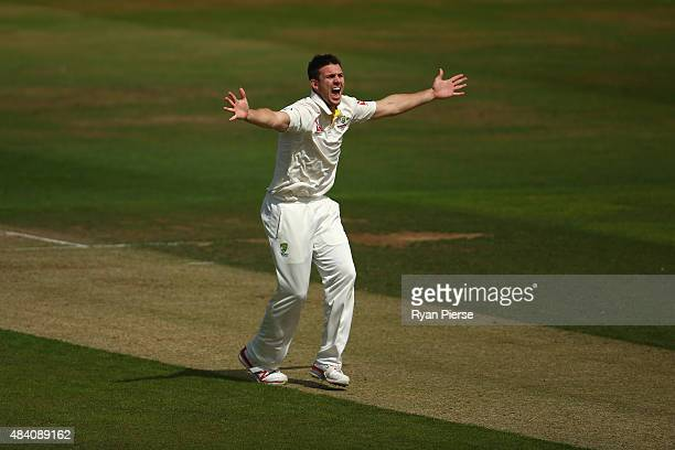 Mitch Marsh of Australia celebrates after taking the wicket of Ben Duckett of Northamptonshire during day two of the tour match between...