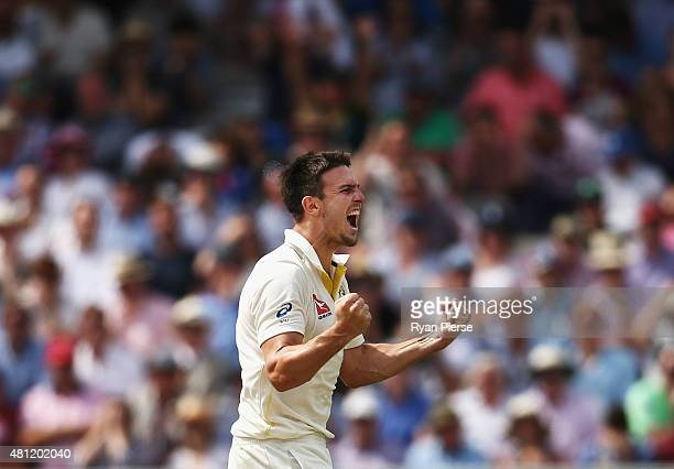 Mitch Marsh of Australia celebrates after taking the wicket of Alastair Cook of England during day three of the 2nd Investec Ashes Test match between...
